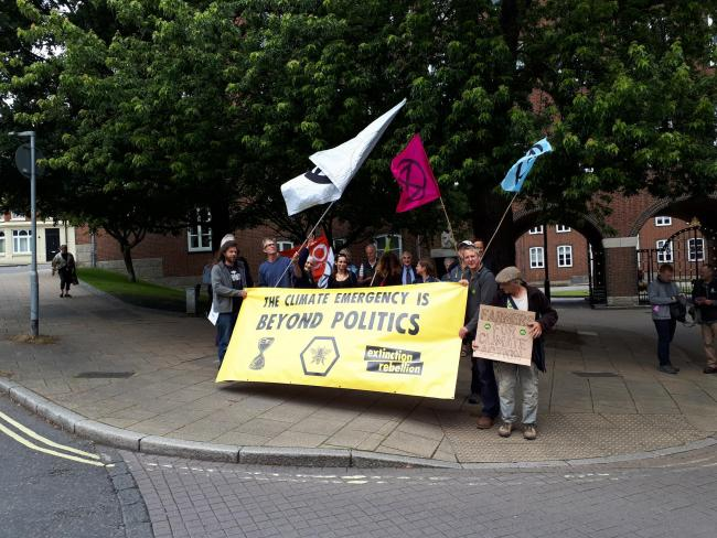 A group of Extinction Rebellion activists outside the Hampshire County Council offices in Winchester