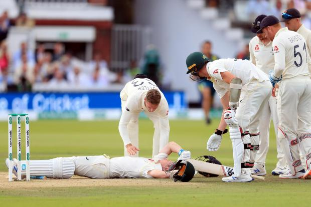 Australia's Steve Smith lies on the ground after being floored by a fierce delivery from Jofra Archer
