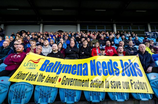 Wrightbus workers and families at Ballymena Showgrounds during a mass meeting after the firm went into administration