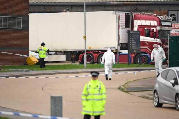 Police examine a lorry container in Essex