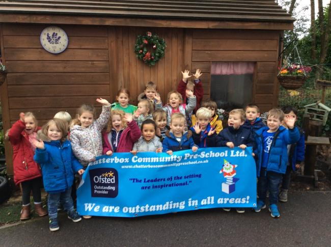 Children celebrating the 'Outstanding' inspection for Chatterbox Community Pre-School
