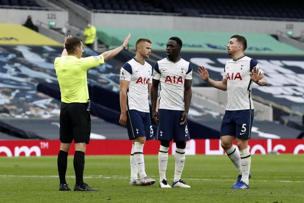 Referee Peter Bankes, left, gave a penalty against Tottenham's Eric Dier for handball during Sunday's game with Newcastle