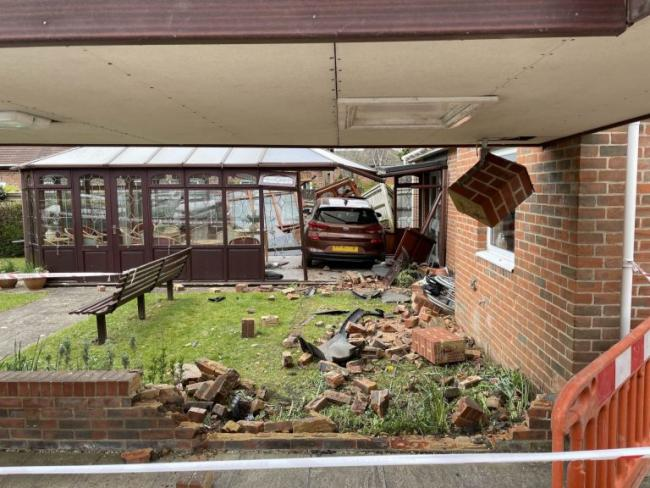 Car crashed into conservatory in Romsey. Photo from: Hampshire and Isle of Wight Fire and Rescue Service.