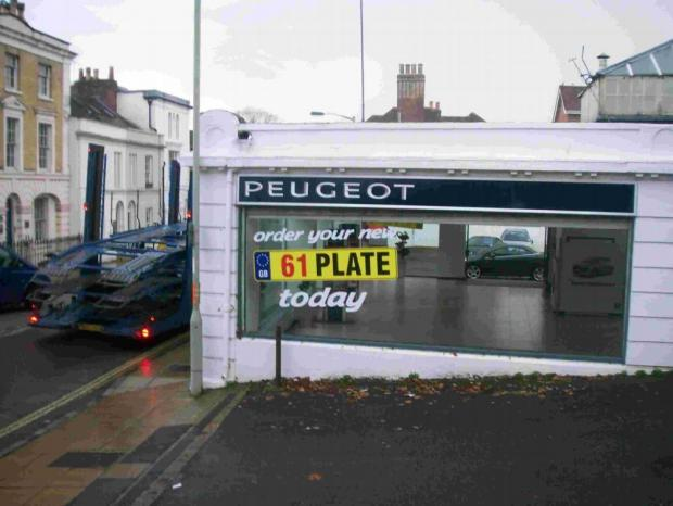 The lorries removing cars from Southgate Peugeot
