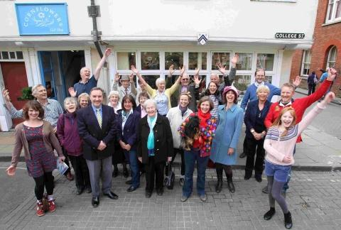 Staff and shoppers celebrate the survival of Cornflowers Gift Shop in College Street