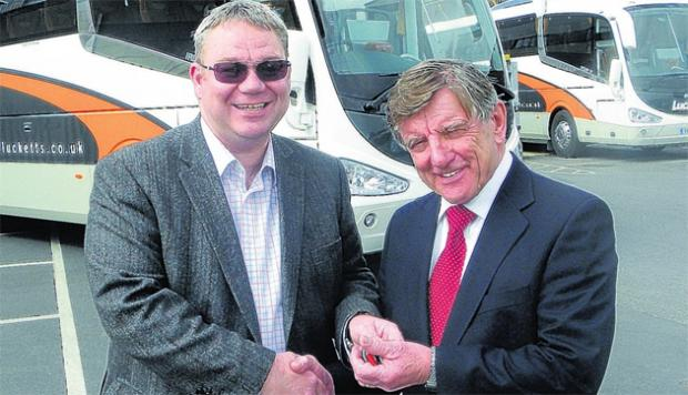 Steve O'Neill (left), commercial director of Irizar UK, hands the keys to David Luckett (right), chairman of Lucketts Travel