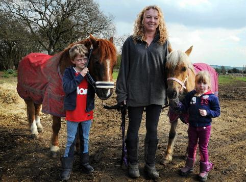 Family saddles up for charity trot