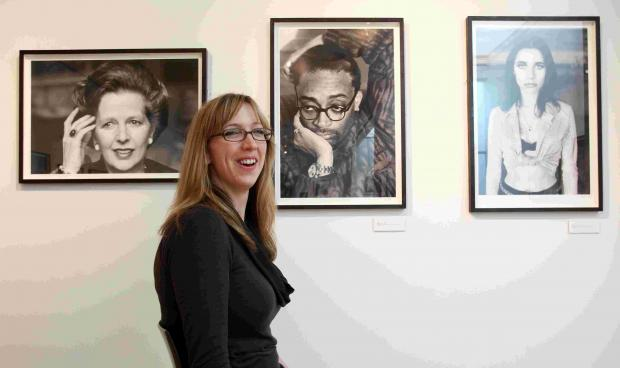Exhibitions officer Kirsty Nutbeen with Jane Bown's images of Margaret Thatcher, Spike Lee and PJ Harvey