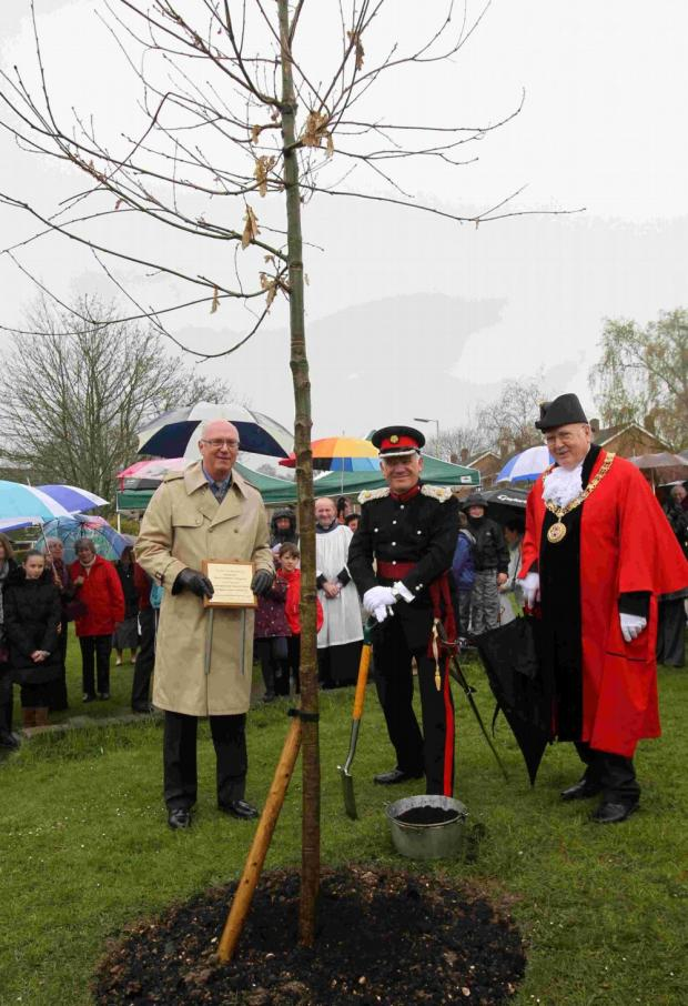 Deputy Lieutenant of Hampshire Andrew Kent (centre) at the tree planting in Littleton with parish council chairman Derek Hickman (left) and mayor of Winchester, Cllr Barry Lipscomb