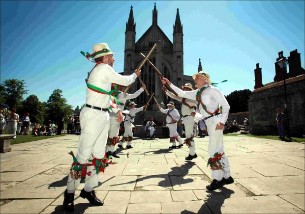Winchester Morris Men outside the cathedral at Mayfest last year