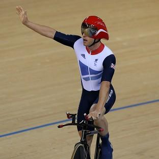 Great Britain's Mark Colbourne waves to the crowd after winning a silver medal in the velodrome