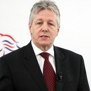First Minister Peter Robinson has condemned the killing of a prison officer on his way to work at Maghaberry jail