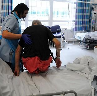 The Royal College of Nurses says NHS staff cuts are coinciding with a soaring demand for care