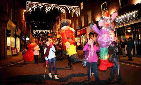 Romsey Advertiser: The lantern parade heads down Winchester High Street