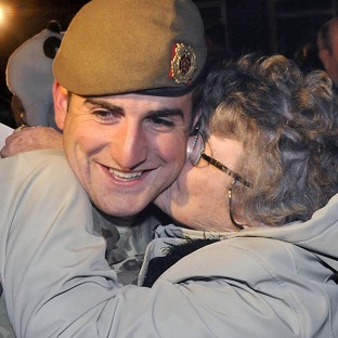 Kingsman Kurtis Done is greeted by his Nan as troops from The Duke of Lancaster's Regiment returned home from Afghanistan (Cpl G Moreno RLC/MoD/PA)