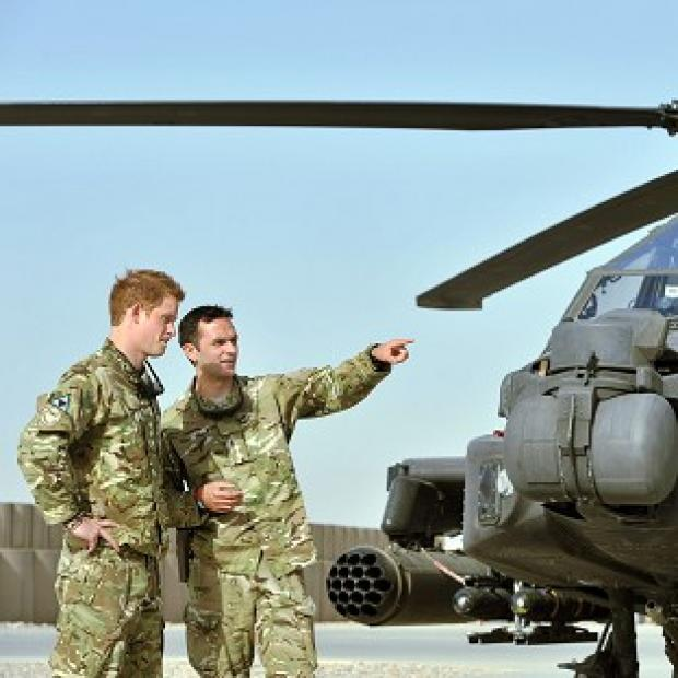 Helicopter pilot Prince Harry, left, is currently stationed at Camp Bastion in Afghanistan