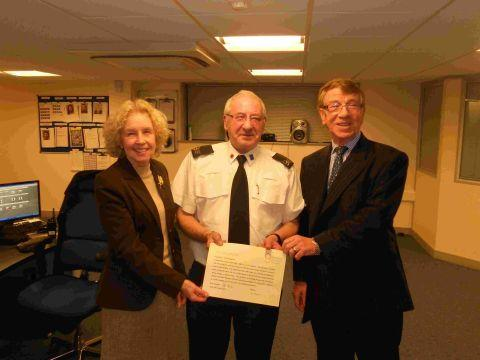 CCTV operator Paul Houghton (centre) is presented with his award by Cllr Patricia Stallard, city council portfolio holder for communities, culture and sport and Frank Adamson, regional director (South) for Broadland Guarding Service