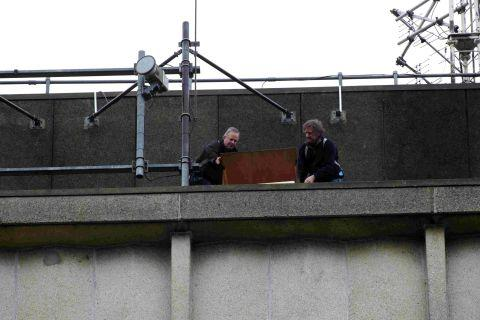 Keith Betton and Jimmy Baldwin of Hampshire Ornithological Society install a falcon box on top of the Hampshire Police headquarters in Romsey Road, Winchester