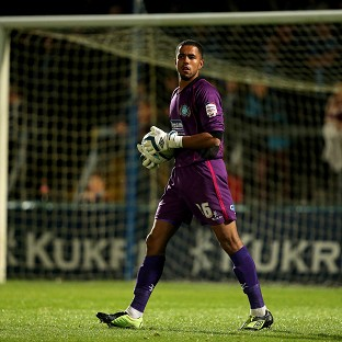 Wycombe Wanderers' Jordan Archer was placing the ball prior to taking a goal kick when the supporter entered the field