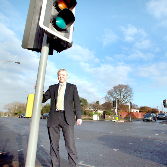 Cllr Alan Dowden at the North Baddesley junction at Botley Road and Nutburn Lane, where Hampshire County Council plan to have improvements following his campaigning