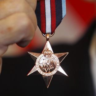 Arctic convoy veteran Eddie Grenfell, 93, with his Arctic Star medal which he received from General Sir David Richards, Chief of the Defence Staff