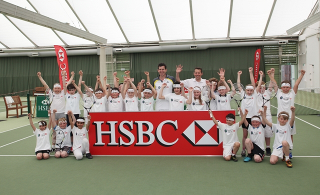 Henman serves up a lesson to school kids