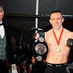 Romsey Advertiser: Richard Buskin after winning the lightweight UFW champion belt