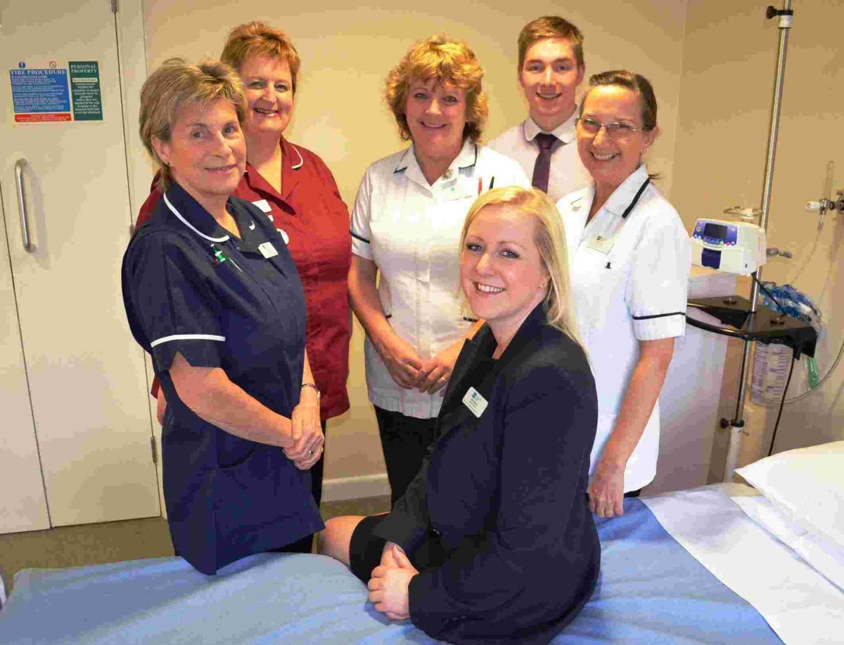 Executive director, Nicola Aspinall, (sitting on bed) with some of her caring team