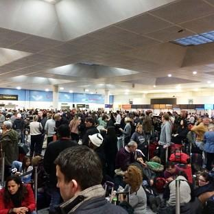 Passengers waiting at the North Terminal at Gatwick as flights were cancelled due to bad weather
