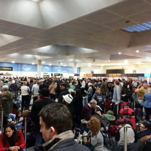 Romsey Advertiser: Passengers waiting at the North Terminal at Gatwick as flights were cancelled due to bad weather (Daniel Cawthorne).