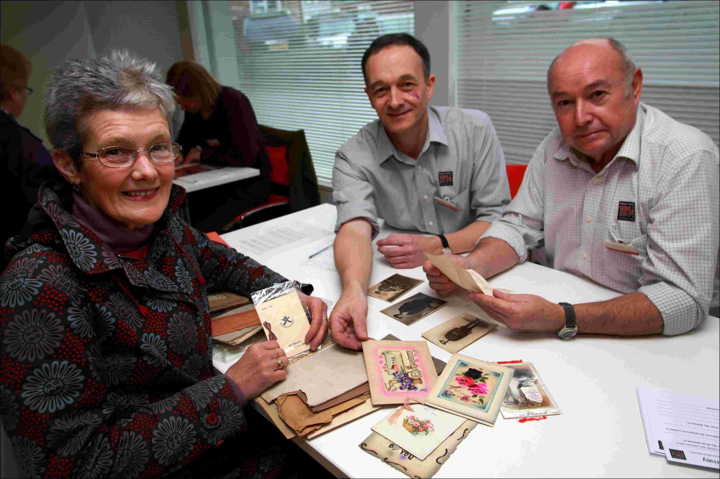 Lynda Emery, left, with artefacts she brought in, with Robin Iles and Patrick Craze of Winchester City Museums.