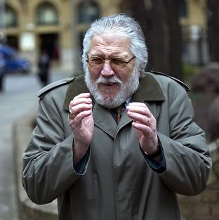 Former DJ Dave Lee Travis arrives at Southwark Crown Court in London, where he is accused of a series of indecent assaults and one sexual assault.