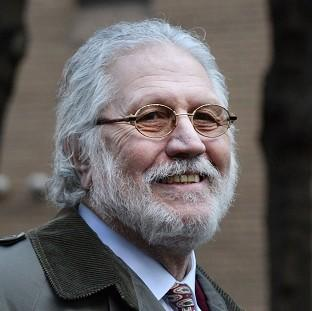 Dave Lee Travis is giving evidence for a third day, defending himself against allegations of indecency