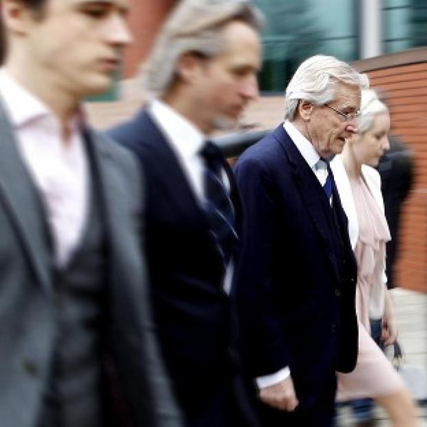 Romsey Advertiser: Coronation Street actor Bill Roache arrives at Preston Crown Court with his sons James and Linus and daughter Verity