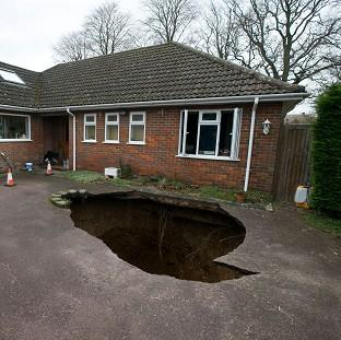 Romsey Advertiser: The home of Phil and Liz Conran, High Wycombe, after a 30ft-deep sinkhole opened up in the driveway and swallowed their car