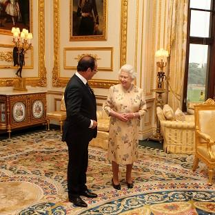 The Queen speaks with French president Francois Hollande at Windsor Castle, Berkshire.