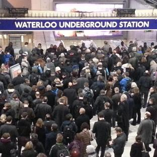 Romsey Advertiser: Commuters queue at the entrance to the London Underground at Waterloo station during the strike
