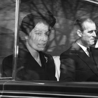 The Queen and the Duke of Edinburgh on their way to Westminster Abbey for her first public engagement as monarch.