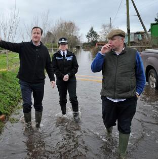 Romsey Advertiser: Prime Minister David Cameron with Bridgwater and West Somerset MP Ian Liddell-Grainger (right) during a visit to Goodings Farm in Fordgate, Somerset