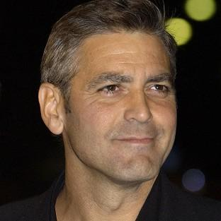 Practical joker George Clooney played a prank on his father by dedicating his latest film to his memory even though he is still alive