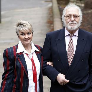 Romsey Advertiser: Former disc jockey Dave Lee Travis arrives at Southwark Crown Court with his wife Marianne.