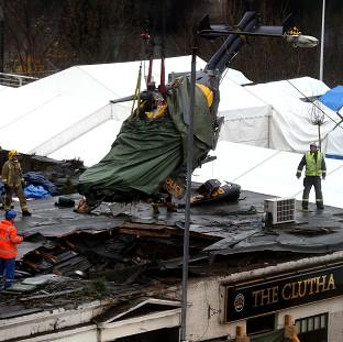 Romsey Advertiser: The wreckage of the police Eurocopter is lifted from the Clutha Vaults in Glasgow following the crash