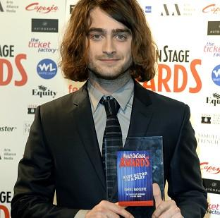 Romsey Advertiser: Daniel Radcliffe with the award for Best Actor in a Play during the What'sOnStage Awards at the Prince of Wales Theatre, London.