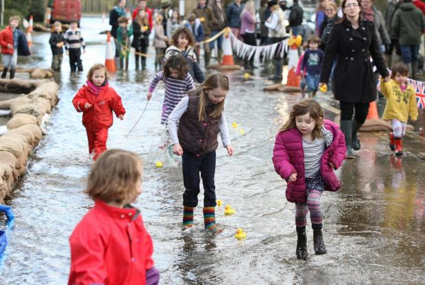 Romsey Advertiser: The Bramdean duck race along the flooded A272