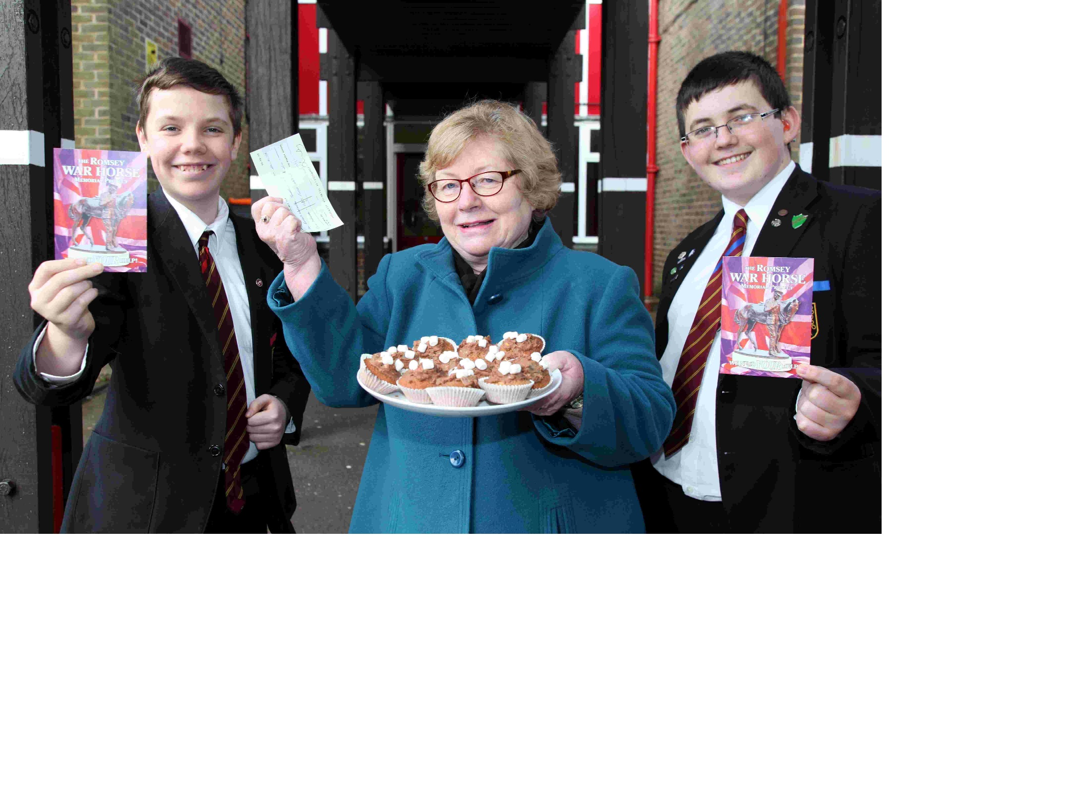 Dorothy Baverstock with Matthew Wakeham, 12, and Sam Egerton-Kemp, 15, from Romsey School, who raised money for the Romsey War Horse project with
