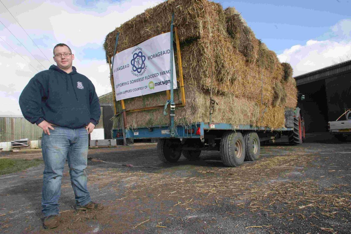 Beaulieu Young Farmer Chris Gray headed up the convoy of tractors taking hay and straw to farms in Somerset after collecting feed from Vale Farm in Pitt.