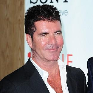 Simon Cowell has given his first interview since becoming a father