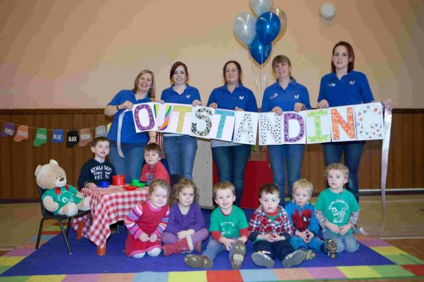 Staff and pupils at Wellow Under-Fives Pre-School spell out their success