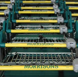 Romsey Advertiser: Morrisons has posted an annual loss of �176 million