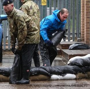 The Duke of Cambridge, who last month helped carry sandbags in Datchet, Berkshire, has along with the Duchess of Cambridge, donated �5,000 to help flood victims in Rhyl, North Wales.